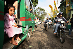 A young girl sits outside the school after her circumcision in Bandung, Indonesia on April 23, 2006. The families of 248 girls were given money to have their children circumcised in a mass circumcision celebration timed to honour the Prophet Mohammed's birthday. While religion was the main reason for circumcisions, it is believed by some locals that a girl who is not circumcised would have unclean genitals after she urinates which could lead to cervical cancer. It is also believed if one prays with unclean genitals their prayer won't be heard. The practitioners used scissors to cut the hood and tip of the clitoris. The World Health Organization has deemed the ritual unnecessary and condemns such practices.