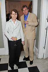 SOPHIE HICKS and THOMAS STUTTAFORD at a party to celebrate the 60th birthday of Mark Shand and the 50th birthday of Tara the elephant held at 29 Portland Place, London on 25th May 2011.