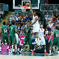 06 August 2012: France Kevin Seraphin dunks the ball during 79-73 Team France victory over Team Nigeria, during the men's basketball preliminary, at the Basketball Arena, in London, Great Britain.