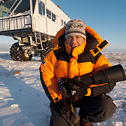 Daniel J. Cox pausing outside of Buggy One on the shores of Hudson Bay near Churchill, Manitoba.