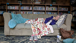 October 10, 2018 - Port St. Joe, Florida, U.S. - Hurricane Michael formed off the coast of Cuba carrying major Category 4 landfall in the Florida Panhandle. Surge in the Big Bend area, along with catastrophic winds at 155mph. WYNELL BURKE, 84, of Port St. Joe, rests at the shelter in the library at the Port St. Joe High School on Wednesday. Burke, who has lived in the city since she was 8 years old, said she is worried about her home because it is surrounded by pine trees. (Credit Image: © Douglas R. Clifford/Tampa Bay Times via ZUMA Wire)