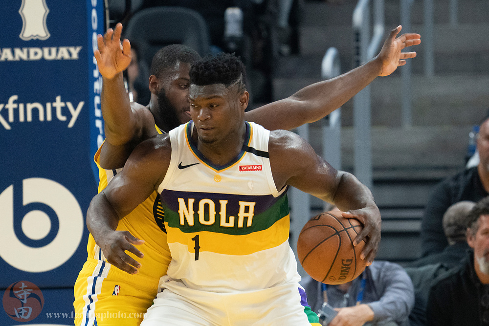February 23, 2020; San Francisco, California, USA; New Orleans Pelicans forward Zion Williamson (1) dribbles the basketball against Golden State Warriors forward Eric Paschall (7) during the second quarter at Chase Center.