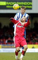 Photo: Leigh Quinnell.<br /> Swindon Town v Chester City. Coca Cola League 2. 24/02/2007. Chesters Laurence Wilson jumps above Swindons Chrsitain Roberts.