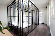 The cheapest place to stay in all of New York? Artist charges one dollar a night...as long as you don't mind sleeping in a jail cell while visitors gawp at you<br /> <br /> When it comes to finding a place to stay for the night, in New York things don't always come cheap.<br /> <br /> However, one Chinese artist from Brooklyn is offering people the chance to stay in his apartment for a bargain $1 a night. <br /> <br /> There are, however, a few conditions that you would have to feel comfortable with, including being filmed for the entire length of your stay in the cell.<br /> Miao Jiaxin listed his room on Airbnb. Although renters will be housed in his studio, it appear to have more in common with a jail cell than a regular bedroom as a cage in the center of the room is where you will stay. <br /> <br /> A small camp bed is where you'll spend your nights. If you think it looks painful, think of the money you're saving on hotel <br /> <br /> It's all in the name of art as occupants must agree to be on display for three hours each day between 9am and midday.<br /> <br /> Jiaxin says that in order to live in his jail cell, you don't have to be a criminal, but there are a number of rules that need to be followed.<br /> The cage is monitored and reported via live stream online 24/7 and occupants will be able to enjoy the room as they please from 9pm until 9am.<br /> <br /> Guests must stay in the case for three hours in the morning without any access to the internet.<br /> <br /> 'From 9:00am to 12pm, you CANNOT access internet, NO electronic devices, books, radio, pens or craftwork. You CANNOT talk to anybody. You CANNOT do Yoga or any other exercises. You CANNOT sleep,' writes Jiaxin.<br /> <br /> The activity of guests is monitored and recorded. Despite being required to stay in the caghe for three hours a day, guests are given a key for them to lock and unlock the cage as they please. <br /> <br /> The apartment is located in Bushwick, Brooklyn - just 15 minutes by subway from the Lower East Side. <br /> Guests also have access to a brand new bathroom equipped with toilet and shower, along with fresh s