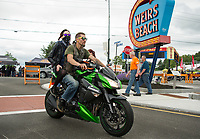 Two riders heading down Lakeside Avenue into Weirs Beach on Thursday afternoon.  (Karen Bobotas/for the Laconia Daily Sun)
