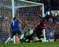 Photo: Tony Oudot.<br /> Chelsea v Blackburn Rovers. The FA Barclays Premiership. 15/09/2007.<br /> Christopher Samba of Blackburn falls awkwardly after a clas with Shevchenko of Chelsea