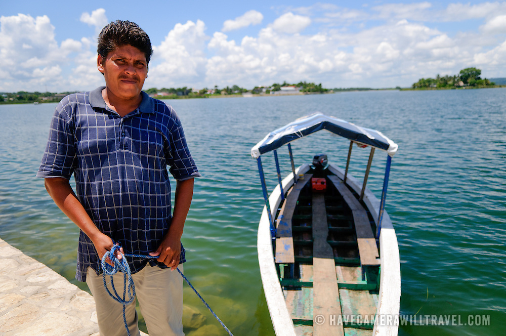 A boatman with his wooden boat on Lake Peten Itza in Flores, Guatemala.