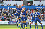 Steven Naismith of Everton heads the ball clear in the first half.<br /> Barclays Premier League match, Swansea city v Everton at the Liberty Stadium in Swansea, South Wales on Saturday 19th September 2015.<br /> pic by Phil Rees, Andrew Orchard sports photography.