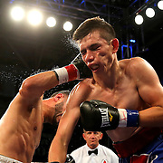 TAMPA, FL - FEBRUARY 28:  Christopher Diaz (L) lands a right cross to the face of Luis Ruiz Jr. during the SoloBoxeo Tecate boxing match at the University of South Florida Sundome on February 28, 2015 in Tampa, Florida. Diaz won the bout by unanimous decision.   (Photo by Alex Menendez/Getty Images) *** Local Caption *** Christopher Diaz; Luis Ruiz Jr.