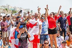 © Licensed to London News Pictures. 24/06/2018. Brighton, UK. England supporters watch the 2018 England v Panama game on the La Luna big screen on the beach in Brighton. Photo credit: Hugo Michiels/LNP