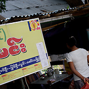 May 15, 2013 - Meiktila, Myanmar: A bus ticket shop in Meiktila, displays a sticker for the 969 anti-Muslim movement. Stickers with the movement's logo are now common nationwide on cars, motorcycles and shops. (Paulo Nunes dos Santos/Polaris)