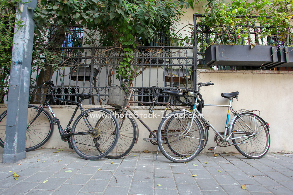 Bicycle locked on the pavement. Photographed in Tel Aviv, Israel