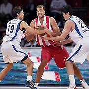Olympiacos's Kostas PAPANIKOLAOU (C) during their Two Nations Cup basketball match Anadolu Efes between Olympiacos at Abdi Ipekci Arena in Istanbul Turkey on Sunday 02 October 2011. Photo by TURKPIX