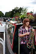 A girl aboard a canal boat on the Grand Union Canal at Hatton in Warwickshire.