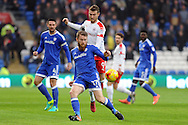 Cardiff City's Aron Gunnarsson is challenged by Barnsley's Sam Winnall (9). EFL Skybet championship match, Cardiff city v Barnsley at the Cardiff city stadium in Cardiff, South Wales on Saturday 17th December 2016.<br /> pic by Carl Robertson, Andrew Orchard sports photography.