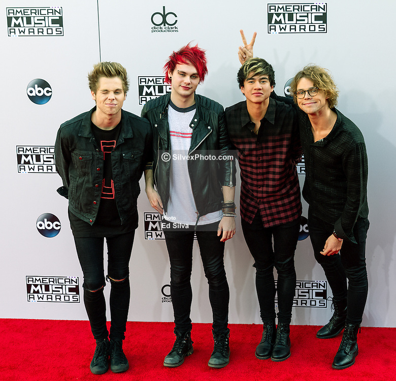LOS ANGELES, CA - NOVEMBER 23: Musicians Luke Hemmings, Michael Clifford, Calum Hood and Ashton Irwin of 5 Seconds of Summer arrive at the 2014 American Music Awards at Nokia Theatre L.A. Live on November 23, 2014 in Los Angeles, California. Byline, credit, TV usage, web usage or linkback must read SILVEXPHOTO.COM. Failure to byline correctly will incur double the agreed fee. Tel: +1 714 504 6870.