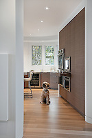 The renovation of a waterfront home in Victoria, BC features walnut cabinetry built by Thomas Philips Woodworking and the creation of a contemporary living space.