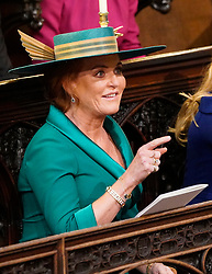 Sarah, Duchess of York takes her seat ahead of the wedding of Princess Eugenie to Jack Brooksbank at St George's Chapel in Windsor Castle.
