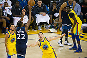 Golden State Warriors guard Klay Thompson (11) defends Minnesota Timberwolves forward Andrew Wiggins (22) at Oracle Arena in Oakland, Calif., on January 25, 2018. (Stan Olszewski/Special to S.F. Examiner)