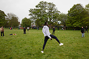 Residents of Napier Barracks having a football kick about with locals as 200 campaigners from different local groups came together today for a festival of solidarity with residents of Napier Barracks, a former military barracks that is being used as an assessment and dispersal facility for asylum seekers by the Home Office on the 21st of May 2021 in Folkestone, Kent, United Kingdom.
