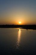 Sunrise over Aravalli Mountain Range at Chattra Sagar reservoir and bird reserve at Nimaj, Rajasthan, Northern India