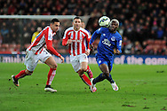 Arouna Kone of Everton ® breaks past Stoke city's Geoff Cameron. Barclays Premier League match, Stoke city v Everton at the Britannia Stadium in Stoke on Trent , Staffs on Wed 4th March 2015.<br /> pic by Andrew Orchard, Andrew Orchard sports photography.