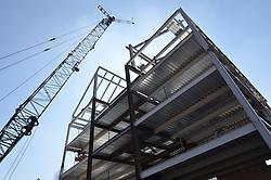 East Elevation Steel Work with Erection Crane. Central Connecticut State University. New Academic Building. Project No: BI-RC-324. Architect: Burt Hill Kosar Rittelmann Associates. Contractor: Gilbane, Inc.
