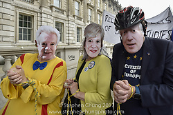 October 14, 2017 - London, UK - London, UK. Anti-Brexit protestors stage a march down Whitehall carrying a mock coffin with the representing the death of democracy.  Protestors carried European flags and were joined by others wearing masks of (pictured) David Davis, Theresa May and Boris Johnson. (Credit Image: © Stephen Chung/London News Pictures via ZUMA Wire)