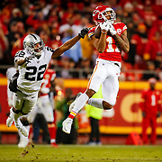 KANSAS CITY, MO - DECEMBER 30: Demarcus Robinson #11 of the Kansas City Chiefs catches the fiftieth touchdown pass of the season for Patrick Mahomes #15 on an 89-yard touchdown in front of Rashaan Melvin #22 of the Oakland Raiders during the third quarter of the game at Arrowhead Stadium on December 30, 2018 in Kansas City, Missouri. (Photo by David Eulitt/Getty Images)