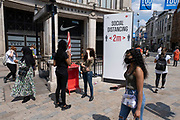 Oxford Circus undergroud station entrance as some non-essential shops re-open, shoppers return to Oxford Street while social distancing measures are put in place by the various retail shops which are open on 26th June 2020 in London, England, United Kingdom. As the July deadline approaces and government will relax its lockdown rules further, the West End remains quiet, apart from this popular shopping district, which itself has far fewer people on its pavements than normal.
