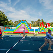 August 16, 2014, New Haven, CT:<br /> Guests participate in a family clinic during Military Night on day four of the 2014 Connecticut Open at the Yale University Tennis Center in New Haven, Connecticut Monday, August 18, 2014.<br /> (Photo by Billie Weiss/Connecticut Open)