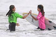 Chloe Groube and Leia Millar. U16 Girls.<br /> Surfing New Zealand National Championships 2021. Piha Beach, Auckland, New Zealand. Tuesday 12 January 2021.<br /> © image by Andrew Cornaga / www.Photosport.nz