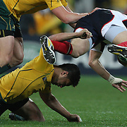 Anthony Fainga'a, Australia, is knocked out as he attempts to tackle Chris Wyles, USA,  during the Australia V USA, Pool C match during the IRB Rugby World Cup tournament. Wellington Stadium, Wellington, New Zealand, 23rd September 2011. Photo Tim Clayton...