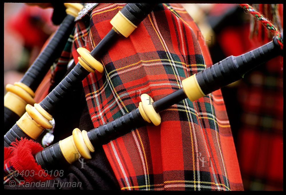 Detail of a bagpiper's tartan and pipes during performance at Highland Games in Inverness. Scotland