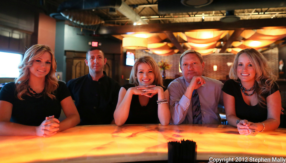 Bartender/Server Andrea Carnes (from left), General Manager Tim Oathout, Server Nicole Page, Owner Dan Marquardt, and Server Stephanie Mulligan at the bar at Zeppelins Bar & Grill, 5300 Edgewood Road NE, in Cedar Rapids on Monday, August 6, 2012.