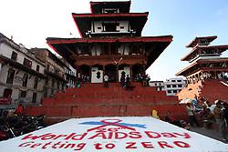 KATHMANDU, Dec. 1, 2013  A symbol of red ribbon is seen to mark the World Aids Day at Hanumandhoka Durbar Square in Kathmandu, Nepal, Dec. 1, 2013. Various programs were organized on the World Aids Day with the them of ''Getting to Zero' (Credit Image: © Xinhua via ZUMA Wire)