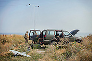 'Master' and his team are setting up to launch an unmanned surveillance aircraft (drone), being used in collaboration with the Ukrainian army and patriotic volunteers' groups, to collect visual information over pro-Russia separatists' positions, in an undisclosed location near the village of Berdyans'ke, 2 km from the frontline town Shyrokine, southeast Ukraine.