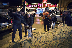 © Licensed to London News Pictures. 13/01/2017. Great Yarmouth, UK. Residents fill sandbanks on the seafront in Great Yarmouth. The Environment Agency has warned residents to prepare for evacuation as as they fear flooding at tonight's high tide. Photo credit: Peter Macdiarmid/LNP