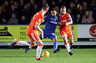 AFC Wimbledon striker Andy Barcham (17) battles for possession with Blackpool midfielder Jay Spearing (8) during the EFL Sky Bet League 1 match between AFC Wimbledon and Blackpool at the Cherry Red Records Stadium, Kingston, England on 29 December 2018.