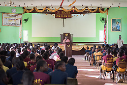 4 November 2019, Vriginia, Liberia: School principal Dr Olu Menjay leads morning devotion at Ricks Institute. The Liberia Baptist Convention runs Ricks Institute, a day and boarding school for currently 496 students from kindergarten up through 12th grade.