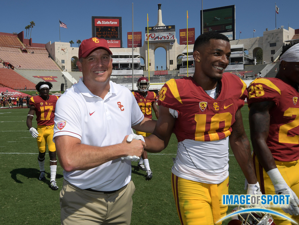 Sep 10, 2016; Los Angeles, CA, USA; USC Trojans head coach Clay Helton celebrates with wide receiver Jalen Greene (10) after a NCAA football game against the Utah State Aggies at Los Angeles Memorial Coliseum. USC defeated Utah State 45-7.