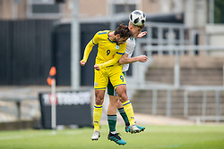 NEWPORT, WALES - Tuesday, November 19, 2019: Wales' Ryan Astley and Kosovo's Artan Asani during the UEFA Under-19 Championship Qualifying Group 5 match between Kosovo and Wales at Rodney Parade. (Pic by Paul Greenwood/Propaganda)