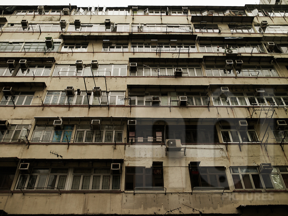 Frontage of a building with air conditioning installations. Hong Kong, China, Asia