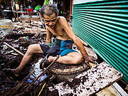 19 OCTOBER 2017 - BANGKOK, THAILAND: A man scavenges for things left behind after an eviction in Pom Mahakan slum in Bangkok. Most of the people living in the slum have been evicted, and the land they were living on has been turned into a volunteer center for people helping with the royal cremation, which is October 25-29, 2017. After the cremation the land will be turned into a public park.     PHOTO BY JACK KURTZ
