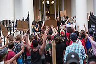 "Hundreds gathered for a vigil and a protest in solidarity with the people of Ferguson Missouri, in New Orleans on Aug. 14th at 6 pm. for Michael Brown who was killed by police in Ferguson on August 9, 2014<br /> After the vigil they took to the streets and marched to the police station on Royal Street. Before entering the lobby and holding an impromptu rally they chanted  ""Hands up, don't shoot,"" in front of the station's entrance"