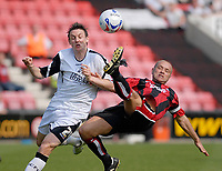 Photo: Leigh Quinnell.<br /> AFC Bournemouth v Swansea City. Coca Cola League 1. 14/04/2007. Swanseas Darryl Duffy just escapes the boot of Bournemouths Neil Young.