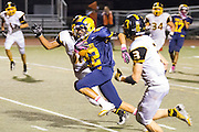 Milpitas High School sophomore, Victor Rodriguez (22), rushes the football down the field during the Oct. 5, 2012, home game against Mountain View.  The Trojans would go on to win 42-7.  Photo by Stan Olszewski/SOSKIphoto.