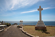 Memorial to Sir William Duff, governer of New South Wales. The Waverley Cemetery opened in 1877 and is a cemetery located on top of the cliffs at Bronte in the eastern suburbs of Sydney. It is noted for its largely intact Victorian and Edwardian monuments. The cemetery contains the graves of many significant Australians including and the poet Henry Lawson and Australia's first Prime Minister, Sir Edmund Barton, who is interred at South Head...Architecturally, Waverley Cemetery is significant in that it showcases examples of Stonemasonry and funerary art dating back from the 19th century,with features (such as the gates, buildings and fencing) that due to their intact nature are considered of outstanding aesthetic value...Poetically, the juxtaposition of the tombs and memorials overlooking the pacific ocean of the sea makes the cemetery a unique place.