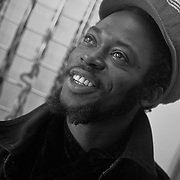 Portrait in black and white of Moses. He is 'the hardest working man in Kensington Market'. An ambitious small business owner/entrepreneur that started on the street, he now has his own store.<br /> Photo made in Kensington Market, Toronto