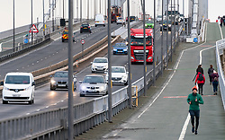 South Queensferry, Scotland, UK. 30 January 2020.  Queensferry Crossing bridge closed and Forth Road Bridge opened to all traffic this morning as temporary traffic diversion experiment is carried out. Highway operators are investigating the feasibility of diverting traffic from M90 from Queensferry Crossing onto the Forth Road Bridge at times when the Queensferry Crossing has to close because of ice on the cables for example. Extensive traffic management works are required however because no direct traffic access points were constructed between carriageways on each bridge.  Pic; traffic and pedestrians are using the Forth Road Bridge today. Iain Masterton/Alamy Live News